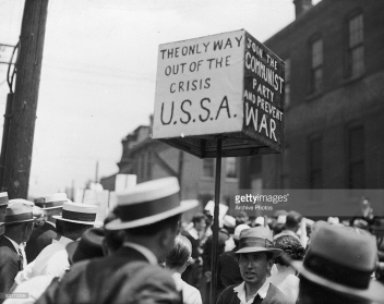 Communist protest in the 1930s, unidentified US city. Source: http://www.gettyimages.com/detail/news-photo/men-carry-signs-reading-the-only-way-out-of-the-crisis-u-s-news-photo/83173506